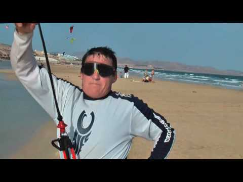 Kitesurfing – learning a beach start and jump unhooked.  A total amateur.
