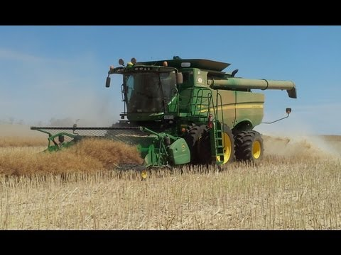 canola - Harvesting canola at Nerrina Farms, our John Deere S670 combine with a hired canola pickup attached. Check out where our canola goes: http://www.youtube.com/...