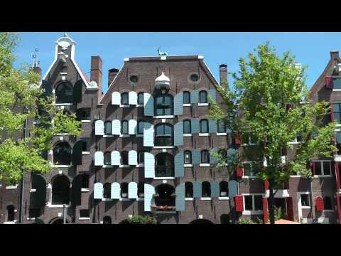 amsterdam - http://www.inyourpocket.com A tour of Amsterdam from the Central Station past the massive Bicycle Park (Fietsflat) to Dam Square, the Royal Palace and the Na...