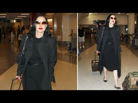 Dita Von Teese Keeps It Classy In All Black And Red Lipstick At LAX
