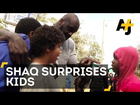 Watch NBA Star Shaq + Police Officers Build Community