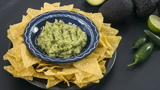 Guacamole is one of the most popular Mexican dish,  known worldwide, that is very easy to prepare and is suitable for any occasion. It is a perfect appetizer that can be served with tortilla chips for a great texture.  To print the recipe check the full recipe on my blog: http://www.homecookingadventure.com/recipes/perfect-guacamoleIngredientsMakes about 3-4 servings2 ripe avocados, peeled and seededJuice from half of lime1/2 red onion, minced1/2 jalapeno pepper, seeds removed, minced1/2 ripe tomatoes, seeds and pulp removed, chopped2 tbsp fresh cilantro or parsley, chopped1/2 tsp (3g) saltfreshly ground black pepper1. Put the avocado into a bowl. Sprinkle with lime juice. Mash avocado with a fork until almost smooth. 2. Fold in onion, jalapeno, tomato, cilantro, salt and pepper to taste. If you like it more spicy add more jalapeno. 3. Cover with plastic wrap directly on the surface of the guacamole. This way you prevent oxidation. Refrigerate until serving. Serve with tortilla chipsBackground music Follow me:FACEBOOK: https://www.facebook.com/homecookingadventureINSTAGRAM: http://instagram.com/homecookingadventurePINTEREST: http://www.pinterest.com/homecookingadv/WEBSITE:http://www.homecookingadventure.com/GOOGLE+: https://plus.google.com/+Homecookingadventurerecipes