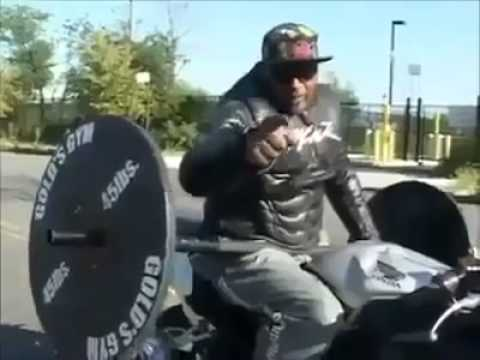 Crazy Motorcycle Rider Weight Lifting While Wheelie