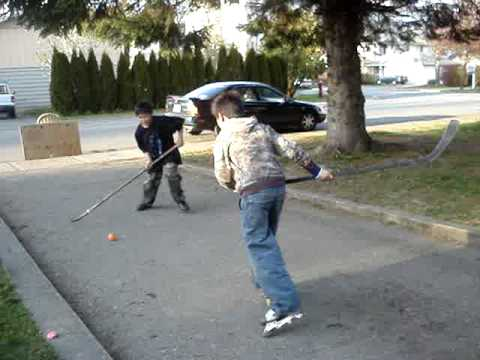 SCORESTREETHOCKEYSHOOTOUT - Hockey game at Knelay's house.