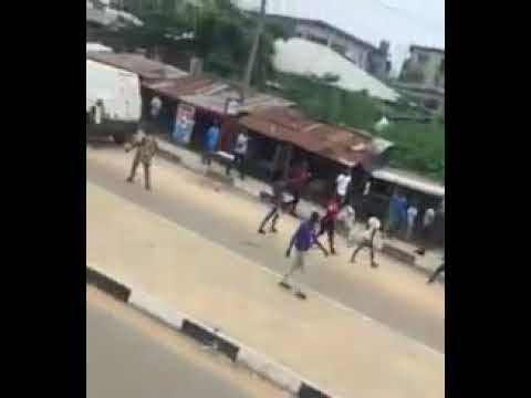 Mile 12 Boys Allegedly Chased SARS Policemen With Stones & Bottles in Lagos