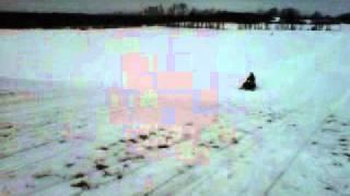 8. Arctic Cat Z440 speedin in field