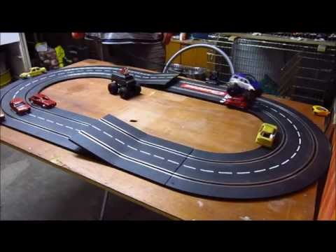 Slot Monster Trucks around my new track layout using  two jumps