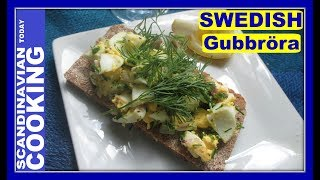 Gubbröra is one of Swedish famous dishes.  This Swedish egg-anchovy sandwich is easy to make and called Gubbröra means Old Man's Mix.  The Swedish anchovies are actually sprats or in Swedish called skarpsill.  However, if you are not able to find skarpsill then regulary anchovies are great with the egg sandwich. Swedish Egg and Anchovy Salad on Crispbread RecipeIngredients:3 hard boiled eggs3 anchovies1 egg yolklemon wedges 🍋 1/4 teaspoon of pepperfresh dill for garnishchopped dillchopped chiveschopped red onioncrisp bread🐟 Instructions:1)Chop up hard boiled eggs. 2)Cut the dill and chives very finely. 3)Place everything in a bowl together with the pepper and egg yolk. Mix them together. 4)Chop the anchovy filets and blend in. 5)Mix everything together and serve cold. 6)This traditional Swedish egg-anchovy salad is served either on crispbread or on a thin slice of round dark bread. 7)Garnish with fresh dill and a lemon wedge on the side. 🍽️ ❄️We hope you enjoyed our video and recipe!  ❄️ Give us thumbs up if you like this video & subscribe for more videos. 👍👍 Thanks! Tak!❄️For notifications of our video release click on the bell (lower left of the video)❄️ SUBSCRIBE to learn how to make Scandinavian dishes. https://www.youtube.com/user/ScandinavianToday❄️ Our Scandinavian Today Cooking Show includes Nordic recipes including Danish, Norwegian, Swedish, Icelandic and Finnish. You might be interested in other Nordic cooking videos includingÆbleskiver ♥ How to Make Danish Aebleskiver with Apple Filling  ❅https://youtu.be/mb8Y9IyfMS4How to make Swedish Glogg for Christmas & cold evenings! (glögg or mulled wine recipe) https://youtu.be/uDJNn6-nZFE?list=PLa1Ox7dzyyvmNEm41VkP1FP_SPhgeUkzSHow to make our easy Danish cucumber salad (Agurkesalat) recipe https://youtu.be/8J-4NPWaTlUHow to make Danish Kringle - A Delicious Danish Pastryhttps://youtu.be/cuqgIlPXlQUNorwegian Cake Recipe - Kvæfjordkake - How to make the World's Best Cake!https://youtu.be/saXxDx1IDo4Finnish Spoon Co