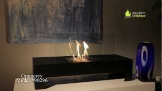 The elegance and clean contemporary design of the glass and black coated metal Gramercy model Anywhere Fireplace™ works...