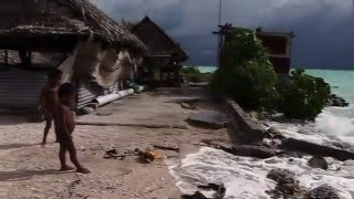 COP21 @UNDP undo.org/cop21 Boobu Tioram, a resident of the Pacific island of Kirabati, took time out from reinforcing a seawall...