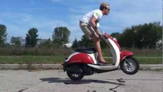 8. 2006 Honda Metropolitan moped scooter jumping