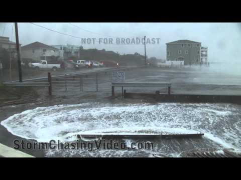 Virginia Beach - Weather Paparazzi storm chasers document amazing footage as Hurricane Irene slams Virgina Beach. #1 Large wave crashing and coming of the top of house near o...