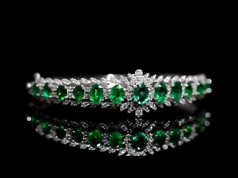 Lady's 18k White Gold 5.4ct (TW) Emerald and Diamond Bangle