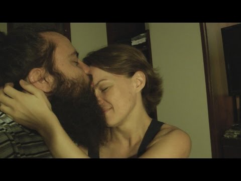 Long time bearded man surprises his girlfriend and family by cutting it off over night