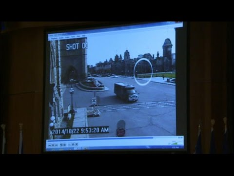 Ottawa - RCMP Commissioner Bob Paulson shows surveillance footage of yesterday's attack on Parliament Hill.