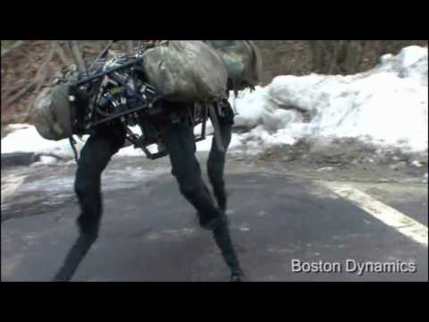 overview - BigDog climbs in the woods, keeps its balance when kicked and when slipping on ice, travels through snow and mud, jogs 5 mph, and climbs some rubble.
