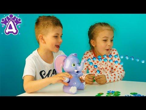 Слоненок пускающий фонтан Игры для детей Распаковка. Elly Fountain Game Распаковка. Розыгрыш игрушки (видео)