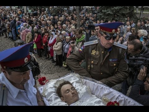 crisis - Anger and questions swirled as residents in the eastern Ukrainian city of Slovyansk buried three men killed in a gunfight at a roadblock on Sunday. Produced ...