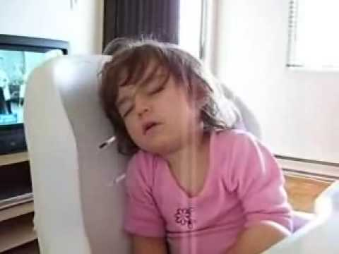 Little girl sleeping in her chair so funny