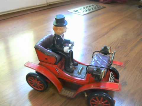 antique Toys 1950's - 1950s Gentleman 1901 Bump and Shake Driving Car Battery Operated Toy Japan.