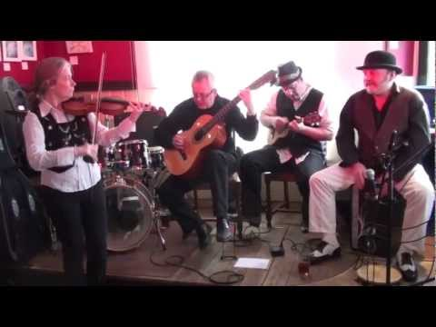 EclectiX1 - Choro Bandido at The Star, Dorking, for OXJAM 2012 Ali - Violin Dave - Cavaquinho Brian - 7 string Guitar Mick - Pandeiro http://www.chorobandido.co.uk.