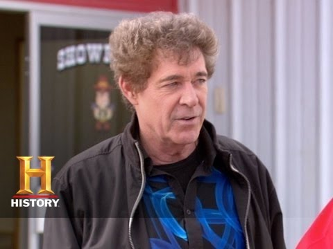 automobiles - TV's Barry Williams drops by the dealership to make an exotic trade for Mark's prized Cadillac.