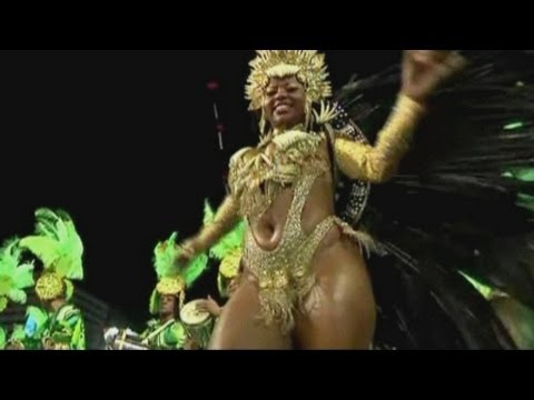 carnival - Scantily-clad beauty queens lead thousands of samba dancers through Rio de Janeiro's Sambadrome as the 15-day party reaches its final blow out. Report by Mat...
