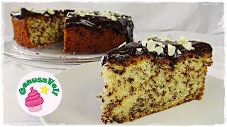 """Rezept für einen saftigen Stracciatella-Kuchen  Ameisenkuchen Rührkuchen mit SchokoladeFolgt mir doch auch auf folgenden Plattformen. Ihr könnt mir darüber auch sehr gern Bilder von Euren Werken schicken :)FACEBOOK: https://www.facebook.com/GenussVoll88INSTAGRAM: https://www.instagram.com/genussvoll_yt/In diesem Video zeige ich Euch ein sehr leckeres und einfaches Rezept für einen Stracciatellakuchen. Das ist ein Rührkuchen mit Schokostreuseln und einer leckeren SchokoglasurFür eine 26er Springfrom benötigt ihr:für den Teig:4 Eier100g Zucker100g brauner Rohrzuckerein EL (oder ein Päckchen) Vanillezucker250g Pflanzenöl (z.B. Rapsöl)250g Joghurt250g Mehl50g Speisestärke1 Päckchen Backpulvereine Prise Salz200g Schokostreuselfür die Schokoglasur:200g Kuvertüre nach Wahl100g Sahne (falls ihr weiße Schokolade benutzt, nehmt nur 50g Sahne!)Ich wünsche Euch ganz viel Spaß beim Nachmachen und gutes Gelingen :) Lasst mir gern Feedback da!Eure AnnikaDas gezeigte Bildmaterial wurde ausschließlich von mir aufgenommen, daher besitze ich das volle Eigentumsrecht.Die Hintergrundmusik ist Gemafreie Musik zur freien Verwendung freigegeben.Music from Epidemic Sound (http://www.epidemicsound.com)__Meine BackutensilienRührmaschine: http://amzn.to/2btkk83 (ich habe das Vorgängermodell und bin sehr zufrieden!) *Handrührgerät: http://amzn.to/2cYnosL *Springform 26cm: http://amzn.to/2bC6XWb *Springform 18cm: http://amzn.to/2b0dVWp *Blechkuchen-Springform 38x25cm: http://amzn.to/2b0dQlv *Tortenring: http://amzn.to/2btl9O8 *Backrahmen: http://amzn.to/2btmlRr *Tarteform: http://amzn.to/2btk494 *Gugelhupfform: http://amzn.to/2b0fFit *Tortensäge: http://amzn.to/2b0g5W6 *Mein FilmequipmentKamera: http://amzn.to/2jqQFUi *Stativ: http://amzn.to/1RjWOq3 *Softbox: http://amzn.to/1RjWXde *Videobearbeitungsprogramm: http://amzn.to/1RiRUA7 ** Alle Amazon-Links und meine """"Stuffwe.Love""""-Shops enthalten Affiliate Links. Das bedeutet, ihr könnt mich darüber ganz einfach und für Euch ganz kostenfrei unterstü"""