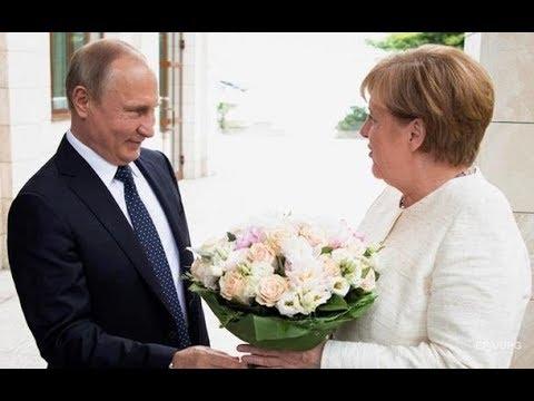 Путин оскорбил букетом Меркель (видео)
