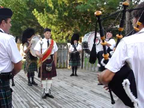 12 Pipers vs. 1 Drummer: Amazing Grace
