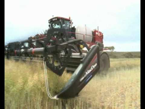 swathing - Miller Nitro 4000 Series self propelled sprayer running Madcon D60 combine front and Honeybee Combine Header swathing.