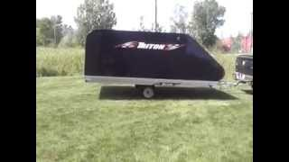 1. Triton XT12 101 Aluminum Tilt Bed Snowmobile Trailer Enclosed