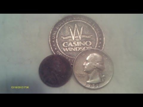 Metal Detecting with Tommy #169 Silver Washington and a $1 casino gaming token.
