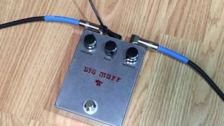 This pedal is a clone of the 1973 version of the Electro-Harmonix Big Muff. I built the pedal myself using the layout from tagboardeffects. I opted out of the mids switch to make the pedal as authentic as possible. No led, but there is a 9 volt plug and true bypass. The enclosure is a 1590BB. I made the decals with clear sticker paper. Water slide decal paper would have been preferable, but I couldn't find any locally and didn't want to order it online.Link to the layout: http://tagboardeffects.blogspot.com/2012/06/ehx-73-rams-head-big-muff.htmlGuitar: Fender Stratocaster with SSL-5 Bridge Pickup, CS69 Middle, FAT50 NeckAmp: Reeves Custom 100Speaker: 2x12 Loaded with Eminence Swamp Thangs