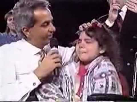 Benny Hinn - Girl get up from wheelchair