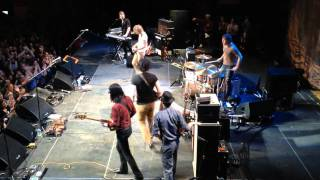 Raconteurs' Jack White hands the crowd his Triple Jet