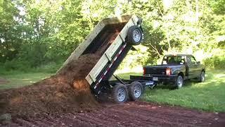 10. Sure Trac Dump Trailer and 2510 Kioti Tractor