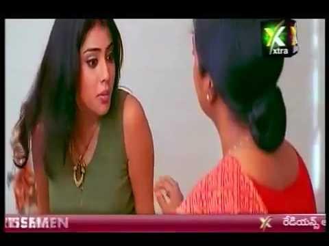 Actress Shriya Saran poses topless