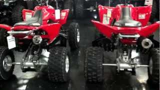 3. 2014 Honda TRX400X Sport ATV Red & Black Beside TRX450R at Honda of Chattanooga in TN