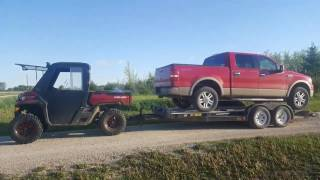 10. Can Am Defender HD8XT pulling crew cab pickup!!