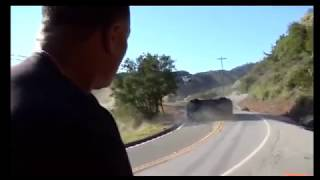 Dr. Dre watches as they crash his Ferrari 360 Modena