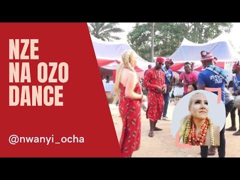 Ezenwa and nwanyi ocha dancing to traditional ogene music after nze na ozo ceremony
