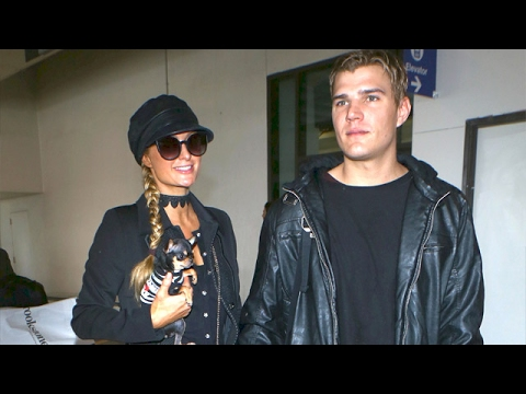 Paris Hilton And Her New Man, Actor Chris Zylka, Arrive In Los Angeles