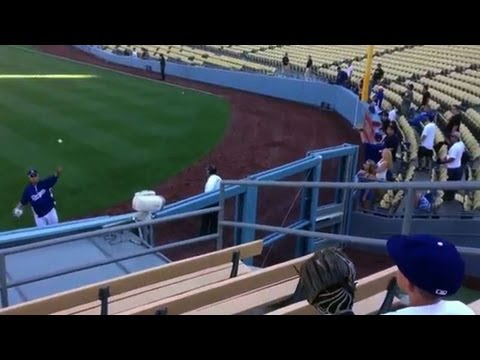 Ryu has a pregame toss with a fan in the bleachers_MLB Baseball, Major League Baseball. MLB's best of the week