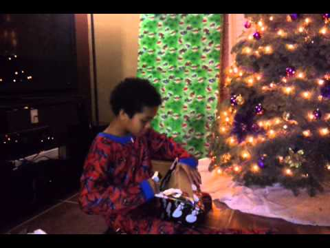 gift reaction funny - Son goes crazy opening his gifts.