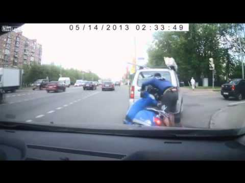 Camera catches a man on a scooter hitting a vehicle, leaving the scene