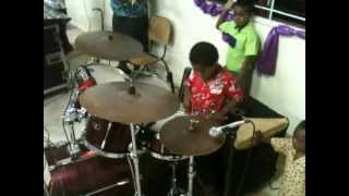 8 year old playing drum in church confidently. Talented young man. Watch till the end to see his skiils....