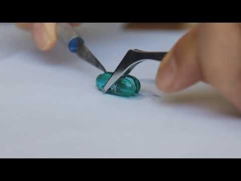 Cutting open an advil pill