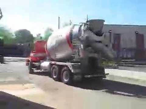mixer - The BIG cement mixer comes rumbling down the street to the job site, where the workmen are waiting. Watch the cement come sliding down the chute while the me...