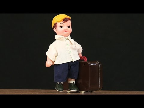 Plane - This wind up toy comes from China, and it was made in the 1980s. The man has a big suitcase, and appears to be in a hurry. We think he is running for the pla...